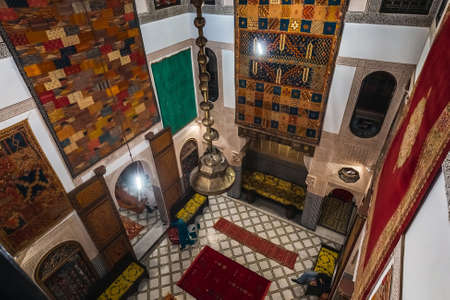 Moroccan ornate interior with carpets at a shop in Medina of Fez, Morocco. Fes, Morocco - April 10 2016.