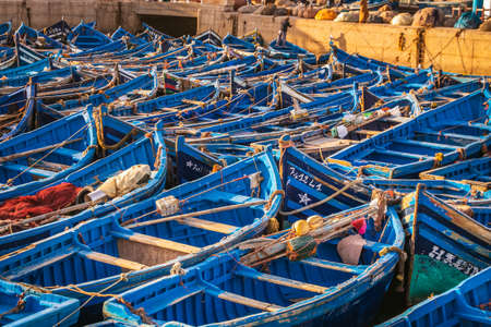 Blue boats at Essaouira port in Morocco. Shot after sunset at blue hour. Essaouira, Morocco - April 14 2016.