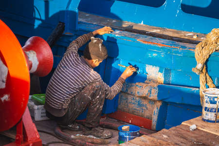 Fisherman fixes the boat at the harbor in Essaouira, Morocco. Essaouira, Morocco - April 14 2016. Editorial