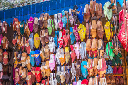 Traditional oriental shoes market stall in Essaouira, Morocco. Essaouira, Morocco - April 14 2016.