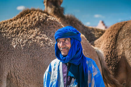 Berber dressed in traditional clothes and turban. Owner of camels at the camel market in Guelmim. Guelmim, Morocco - April 16 2016.