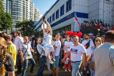 Happy people during biggest peaceful protests in Belarus history against rigged presidential elections in Minsk, Belarus. Minsk, Belarus - August 16 2020. Foto de archivo - 154049248