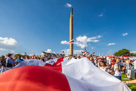 Huge flag during biggest peaceful protests in Belarus history against rigged presidential elections in Minsk, Belarus. Minsk, Belarus - August 16 2020. Foto de archivo - 154049249
