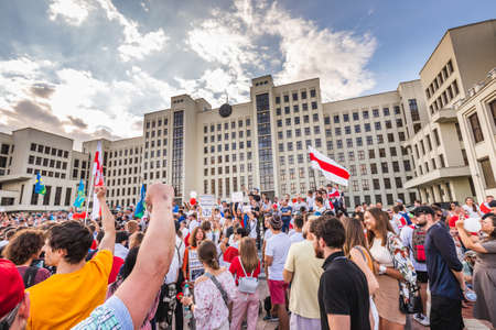 Happy people during biggest peaceful protests in Belarus history against rigged presidential elections in Minsk, Belarus. Minsk, Belarus - August 16 2020. Foto de archivo - 154049228