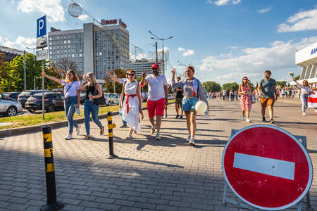 Happy people during biggest peaceful protests in Belarus history against rigged presidential elections in Minsk, Belarus. Minsk, Belarus - August 16 2020. Foto de archivo - 154049232