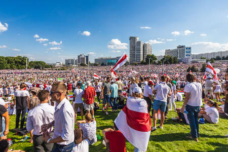 Happy people during biggest peaceful protests in Belarus history against rigged presidential elections in Minsk, Belarus. Minsk, Belarus - August 16 2020. Foto de archivo - 154049236