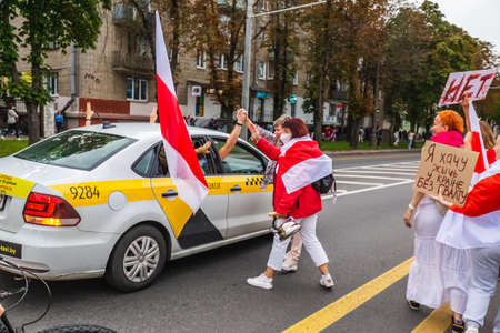 Uber driver with passengers during peaceful protests in Belarus against rigged presidential elections in Minsk, Belarus. Minsk, Belarus - August 30 2020.