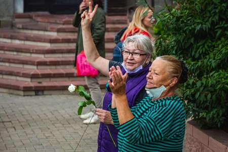 Women during peaceful protests in Belarus against rigged presidential elections in Minsk, Belarus. Minsk, Belarus - August 30 2020. Foto de archivo - 154376242