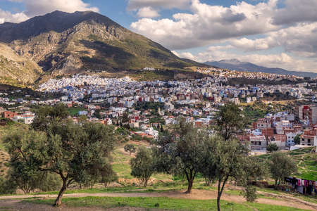 Warm toning. Scenic panoramic view close to a famous blue city of Chefchaouen, Morocco. Фото со стока