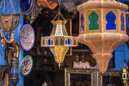 Colorful lamps for sale in Chefchaouen. Blue city medina in Morocco with blue painted walls.