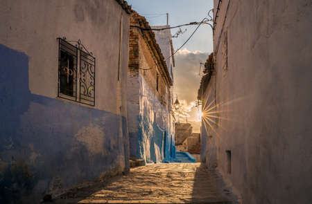 Amazing sunset in Chefchaouen. Blue city medina in Morocco with blue painted walls.