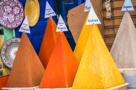 Selection of spices on a traditional Moroccan market (souk) in Essaouira, Morocco.