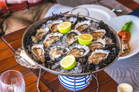 Fresh oysters in Oualidia, a coastal village in Morocco situated between El Jadida and Safi. It is located beside a protected natural lagoon and has been called Morocco's oyster capital.