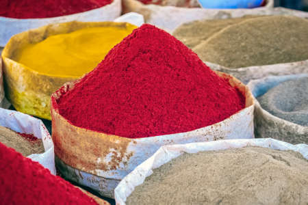Selection of spices on a traditional Moroccan market (souk) in Guelmim, Morocco.