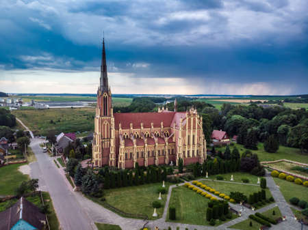 Aerial view over The Church of the Holy Trinity is a Catholic church in the agro-town Gervyaty, Grodno region, Belarus. Built in 1899-1903 in the neo-gothic style.