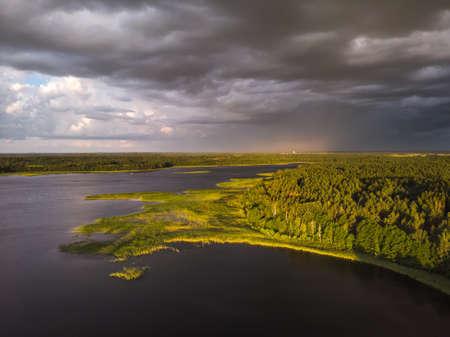Stromy clouds over eautful peninsula between lakes Snudy and Strusto, National Park Braslau Lakes, Belarus.
