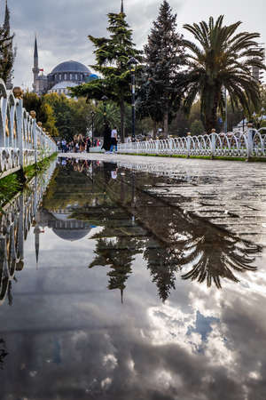 Blue mosque is under a renovation in Istanbul, Turkey. Reflection in the water puddle. Istanbul, Turkey - September 29 2020.