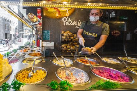 Turkish Baked Potato Mixed Kumpir in Istanbul, Turkey. Istanbul, Turkey - September 30 2020.