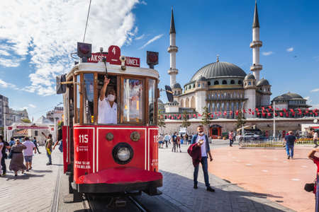 Old red tram on rails at Taksim square. Istanbul, Turkey - September 30 2020.