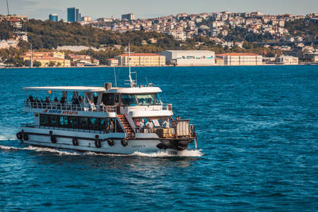 Istanbul shoreline from the boat. Business centers and luxurious mansions with houses over the hills at the shore of Bosphorus. Istanbul, Turkey - October 01 2020. Publikacyjne