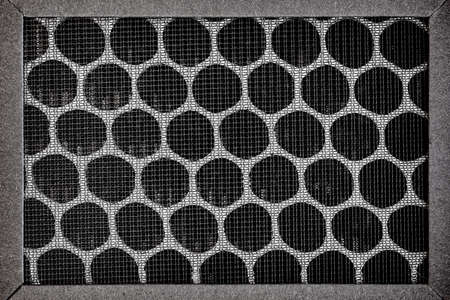 Closeup of HEPA filter. Black cells background
