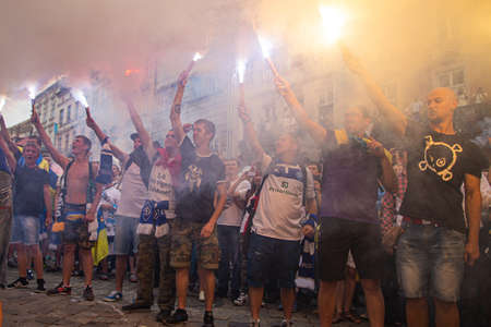 Lviv, Ukraine - July 22, 2014: Unity March of Ultras of FC Dynamo Kyiv, FC Shakhtar Donetsk and FC Karpaty Lviv in Lviv city center