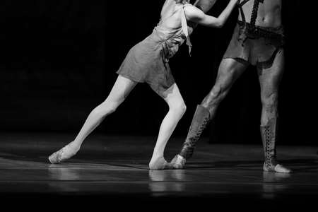 Closeup of classic ballet couple on stage