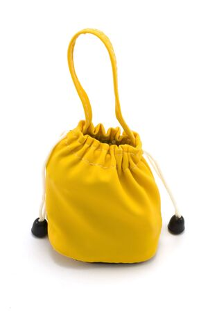 Yellow sac pervaded aromatic stick on white background