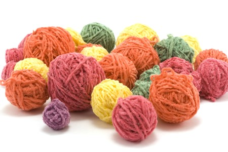Ball of the colour threads insulated on white background photo