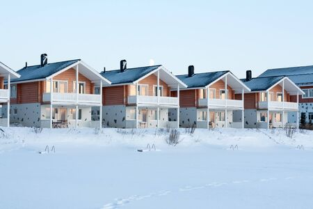 Lodges in snow, sundown, moon, winter, sky photo