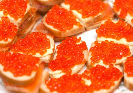 Sandwiches with red roe on white plate photo