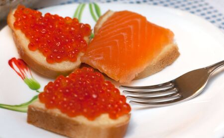 Sandwiches with red roe on white plate, salmon photo