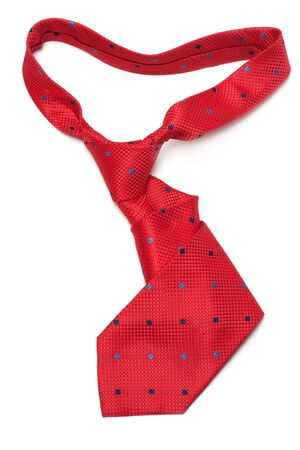 Red silk tie curly on white background photo