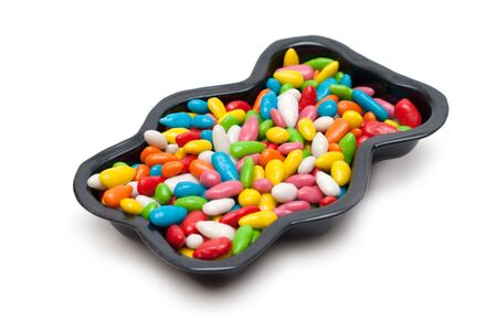 pervaded: Baking tray form pervaded sweetmeat in colour glaze on white background
