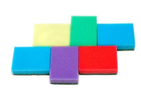 Colour sponges for dishwashing on white background photo