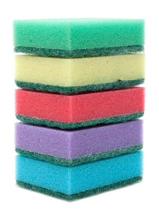 Colour sponges for dishwashing tower on white background photo