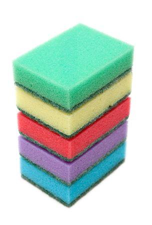 Colour sponges for dishwashing, tower on white background photo