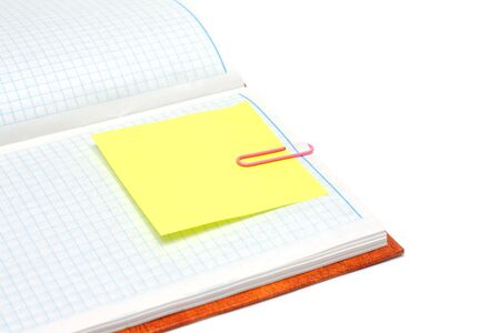 Note pad with plaid paper, yellow bookmark and rose staple Stock Photo - 4963960