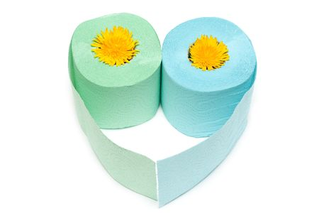 Two rolls of the toilet paper in the manner of heart with yellow colour photo