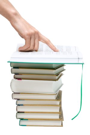 Openning book on pile of the books, hand points to text Stock Photo - 5008179