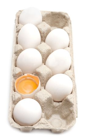 Egg in packing, one is, yolk in shell Stock Photo - 5069235