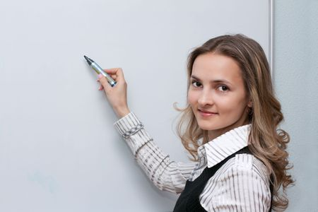 Beautiful making look younger girl beside boards with marker in hand Stock Photo - 5235638