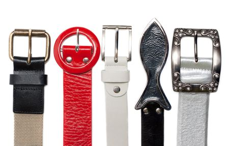 buckles: Buckles leather and rag belt over white background Stock Photo