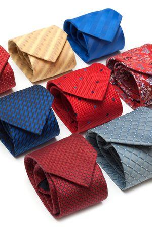 convolute: Varicoloured male ties convolute on white background Stock Photo