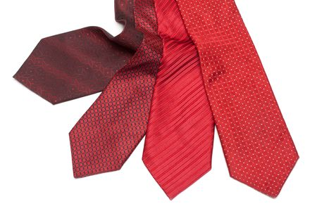 Four male ties, red and crimson on white background Stock Photo - 5192499