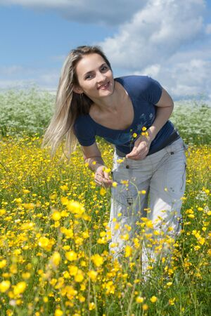 Beautiful making look younger girl in field with yellow flower Stock Photo - 5235639