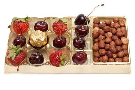 sweetmeat: Sweet cherries strawberries nuts hazelnut and sweetmeat in plastic form Stock Photo