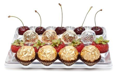 sweetmeats: Sweetmeats strawberries sweet cherries in silvery plastic form Stock Photo