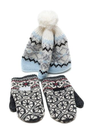nodding: Knitted mittens and nodding on white background