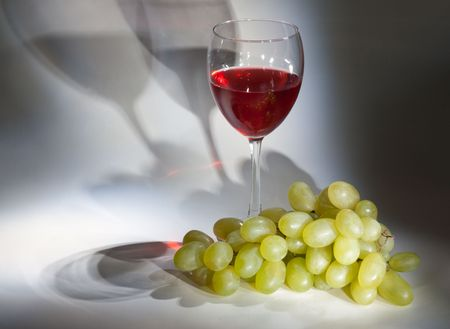 Goblet red wine, white grape with shade on background Stock Photo - 5564383